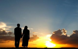 muslim couple and sunset